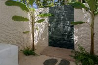 Malahini Kuda Bandos beach villa outdoor shower
