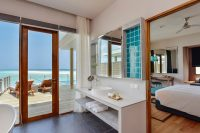 Dhigali Maldives lagoon villa with pool bathroom